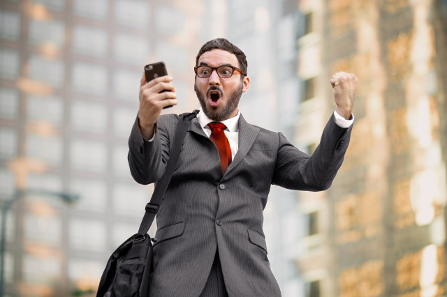 Man-suit-cheer_Fotolia_119488514_Subscription_Monthly_M