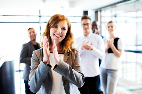 Female-clapping-with-collegues_Fotolia_85653689_M
