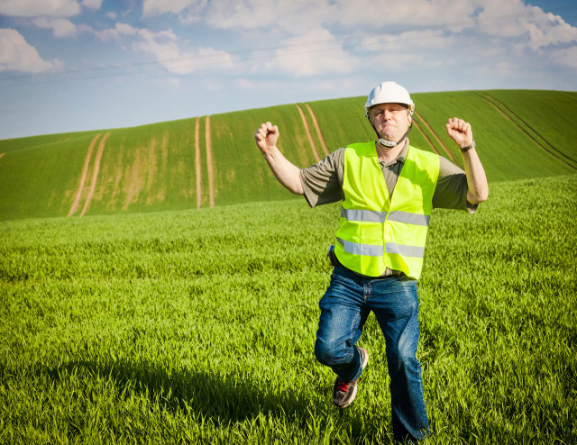 Happy-Dance-Construction-Worker-Fotolia_52284032_M