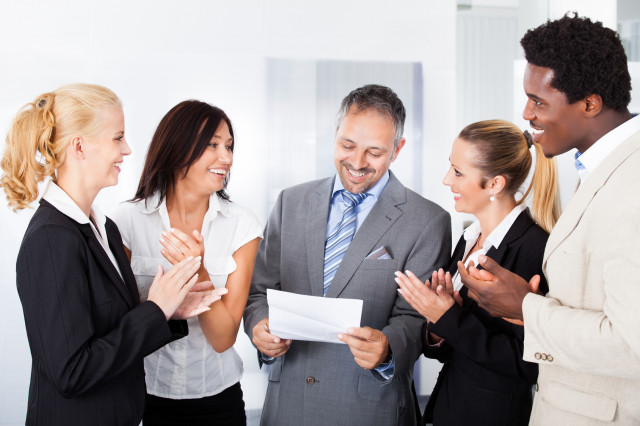 Coworkers-congratulate-Fotolia_55226643_Subscription_Monthly_M