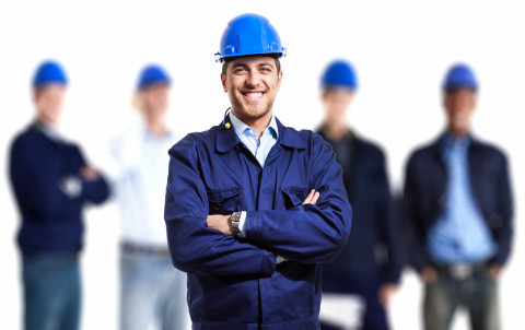 Happy-group-engineers_hardhat_AdobeStock_44636755