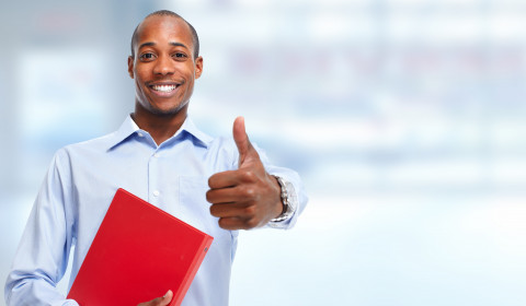 Man-thumbs-up-red-folder_AdobeStock_95571706
