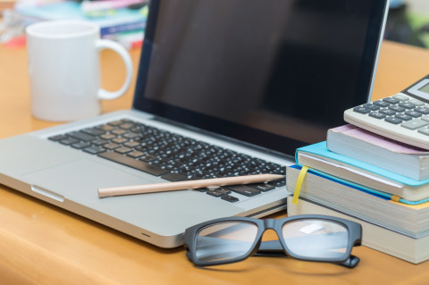 Laptop-glasses-books-learning-concept_AdobeStock_226559951
