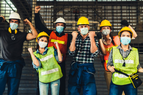Happy-EHS-people-mask-fist-pump_AdobeStock_333965721