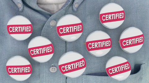 Certified-buttons-on-gray-shirt_AdobeStock_198736042